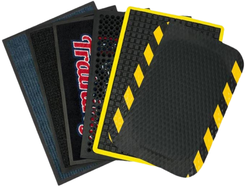 A variety of mats are displayed in a fan shape. Some have yellow safety border, one has a logo and one has holes for water drainage.